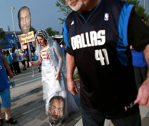 OKLAHOMA CITY ARENA: A Dallas Mavericks fan walks past Thunder fan Meghan Dailey (left) as she makes her way to the OKC Arena before game 4 of the Western Conference Finals in the NBA basketball playoffs between the Dallas Mavericks and the Oklahoma City Thunder at the Oklahoma City Arena in downtown Oklahoma City, Monday, May 23, 2011. Photo by John Clanton, The Oklahoman ORG XMIT: KOD