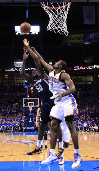 Oklahoma City's Serge Ibaka (9) blocks the shot  of Memphis' Zach Randolph (50) during Game 1 in the second round of the NBA playoffs between the Oklahoma City Thunder and the Memphis Grizzlies at Chesapeake Energy Arena in Oklahoma City, Sunday, May 5, 2013. Photo by Sarah Phipps, The Oklahoman
