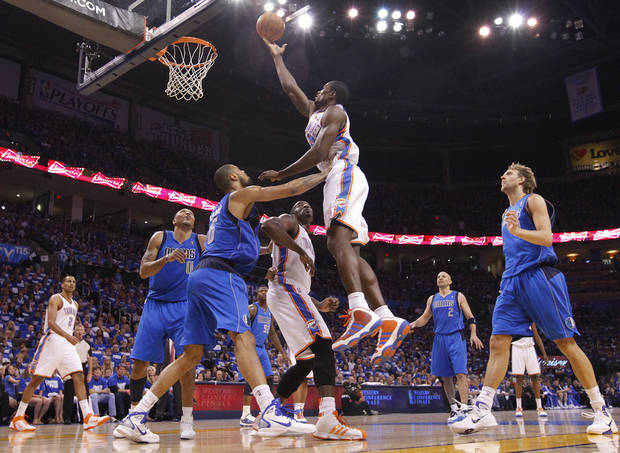 Oklahoma City's Serge Ibaka (9) battles under the basket with Tyson Chandler (6) of Dallas during game 3 of the Western Conference Finals of the NBA basketball playoffs between the Dallas Mavericks and the Oklahoma City Thunder at the OKC Arena in downtown Oklahoma City, Saturday, May 21, 2011. Photo by Chris Landsberger, The Oklahoman