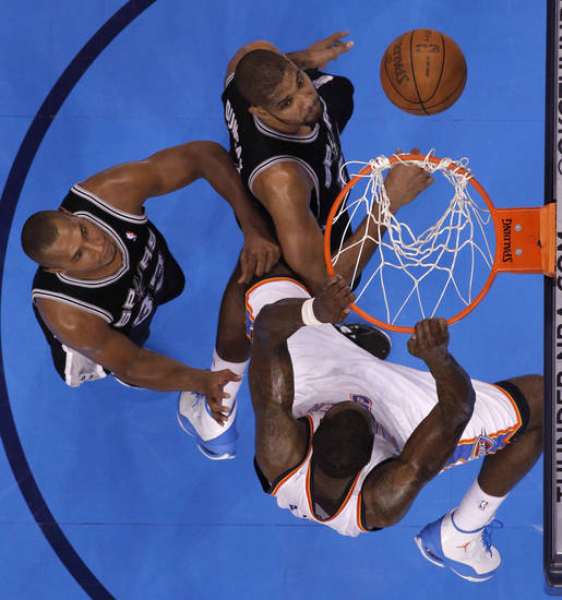 Oklahoma City's Kendrick Perkins (5) dunks the ball over San Antonio's Boris Diaw (33) and San Antonio's Tim Duncan (21) during Game 4 of the Western Conference Finals between the Oklahoma City Thunder and the San Antonio Spurs in the NBA playoffs at the Chesapeake Energy Arena in Oklahoma City, Saturday, May 31, 2012. Photo by Bryan Terry, The Oklahoman