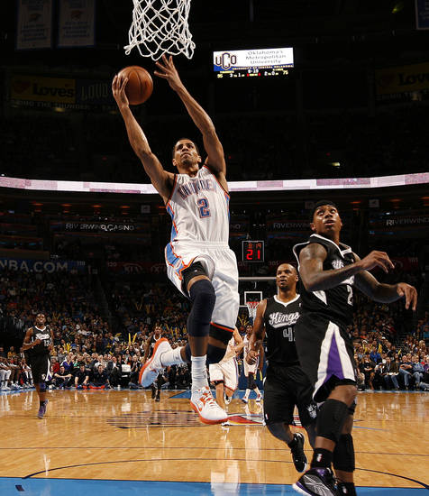 Oklahoma City's Thabo Sefolosha (2) goes to the basket past Sacramento's Isaiah Thomas (22) and Chuck Hayes (42) during an NBA basketball game between the Oklahoma City Thunder and the Sacramento Kings at Chesapeake Energy Arena in Oklahoma City, Friday, Dec. 14, 2012. Photo by Bryan Terry, The Oklahoman