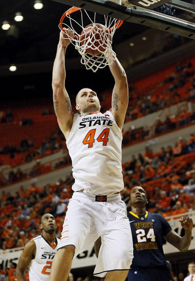 Oklahoma State's Philip Jurick (44) dunks the ball during an NCAA men's basketball game between Oklahoma State University (OSU) and West Virginia at Gallagher-Iba Arena in Stillwater, Okla., Saturday, Jan. 26, 2013. Oklahoma State won, 80-66. Photo by Nate Billings, The Oklahoman