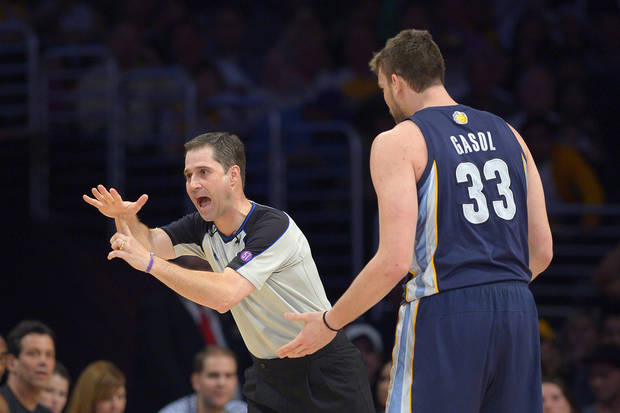 Memphis Grizzlies center Marc Gasol, of Spain,, right, receives a technical foul from referee David Guthrie during the first half of their NBA basketball game against the Los Angeles Lakers, Friday, April 5, 2013, in Los Angeles. (AP Photo/Mark J. Terrill)