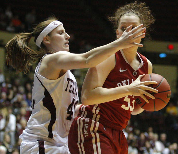 OU's Joanna McFarland (53) is defended by Texas A&M's Kelsey Assarian (40) during the women's college basketball Big 12 Championship tournament game between the University of Oklahoma and Texas A&M in Kansas City, Mo., Friday, March 11, 2011.  Photo by Bryan Terry, The Oklahoman