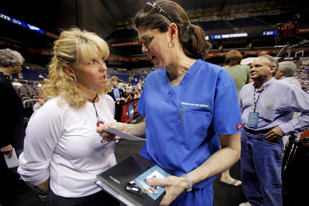 OU coach Sherri Coale, left, talks with  Dr. Tamara Rogers after practice for the Final Four of the NCAA women's  basketball tournament at the Alamodome in San Antonio, Texas., on Saturday, April 3, 2010.  The University of Oklahoma will play Stanford on Sunday, April 4, 2010.