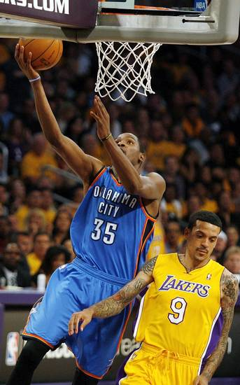 Oklahoma City's Kevin Durant (35) takes a shot next to Los Angeles' Matt Barnes (9) during Game 3 in the second round of the NBA basketball playoffs between the L.A. Lakers and the Oklahoma City Thunder at the Staples Center in Los Angeles, Saturday, May 19, 2012. Photo by Nate Billings, The Oklahoman