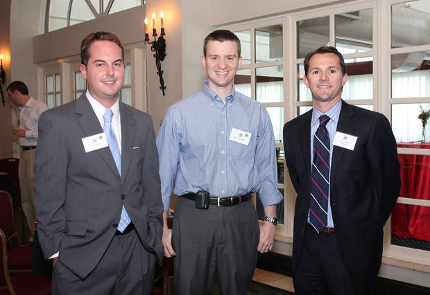 Chay Kramer, Mark Pogemiller and Lance Leffel attend a kick off reception for the 2012 Red Bud race board members.