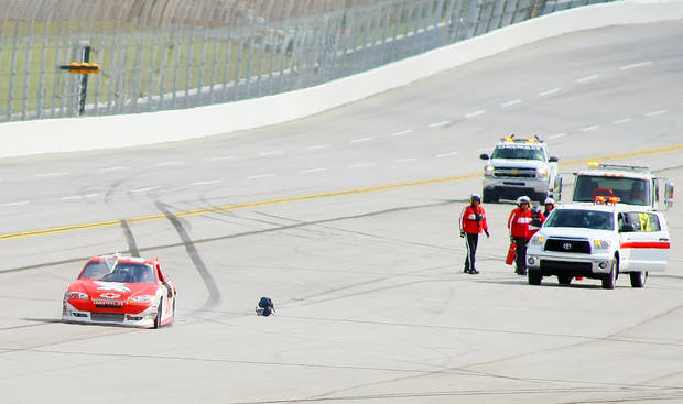 Kurt Busch (51) drives away from safety crew after wrecking during the NASCAR Sprint Cup auto race at Talladega Superspeedway in Talladega, Ala., Sunday, Oct. 7, 2012. (AP Photo/Greg McWilliams)