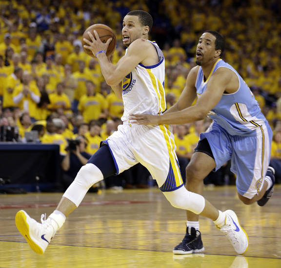 Golden State Warriors' Stephen Curry, left, drives the ball past Denver Nuggets' Andre Miller during the second half of Game 4 in a first-round NBA basketball playoff series on Sunday, April 28, 2013, in Oakland, Calif. (AP Photo/Ben Margot)
