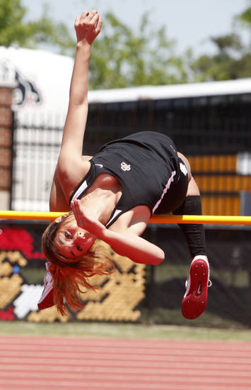 Putnam City's Schuyler Wood clears the bar of the girl's high Jump during the 5A and 6A State Track Meet in Yukon, OK, Saturday, May 11, 2013,  By Paul Hellstern, The Oklahoman