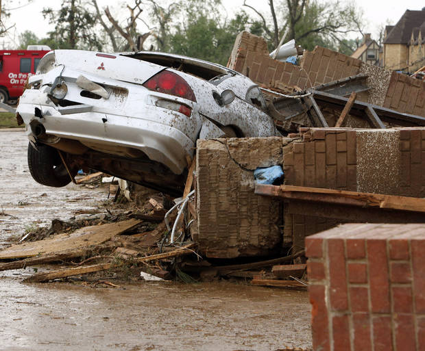 Cars were tossed by a tornado near SW 149th and Western on Monday, May 20, 2013  in Moore, Okla. Photo by Steve Sisney, The Oklahoman