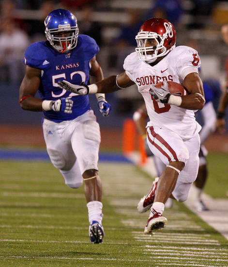 Oklahoma's Dominique Whaley (8) leaps past Kansas' Steven Johnson (52) during the college football game between the University of Oklahoma Sooners (OU) and the University of Kansas Jayhawks (KU) at Memorial Stadium in Lawrence, Kansas, Saturday, Oct. 15, 2011. Photo by Bryan Terry, The Oklahoman