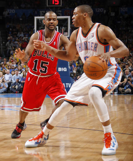Oklahoma City's Russell Westbrook (0) looks to get past Chicago's John Lucas (15) during the NBA basketball game between the Chicago Bulls and the Oklahoma City Thunder at Chesapeake Energy Arena in Oklahoma City, Sunday, April 1, 2012. Photo by Sarah Phipps, The Oklahoman