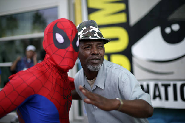 Ray Senore, right, poses with a man dressed as Spiderman at Comic-Con Wednesday, July 11, 2012, in San Diego. The annual comic book and popular arts convention attracts over 100,000 people and runs through July 15. (AP Photo/Gregory Bull)
