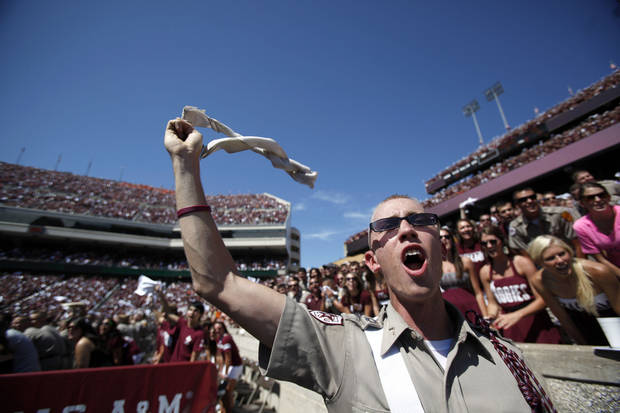 Fans cheer in the first half during the Texas A&M-Oklahoma State game on Saturday. OSU won 30-29. Photo by Sarah Phipps, The Oklahoman