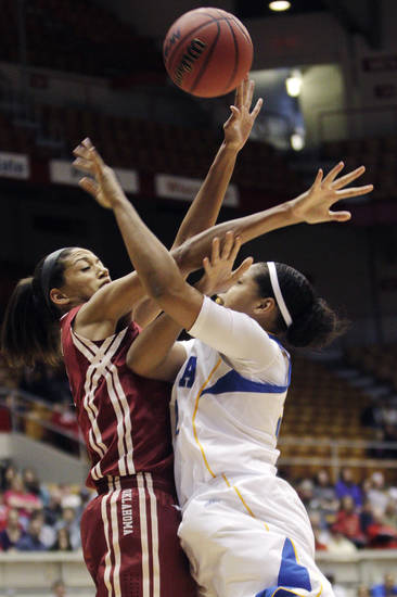Oklahoma's Nicole Griffin, left, fouls UCLA's Alyssia Brewer during the first half of a second-round game in the women's NCAA college basketball tournament, Monday, March 25, 2013, in Columbus, Ohio. (AP Photo/Jay LaPrete) ORG XMIT: OHJL105