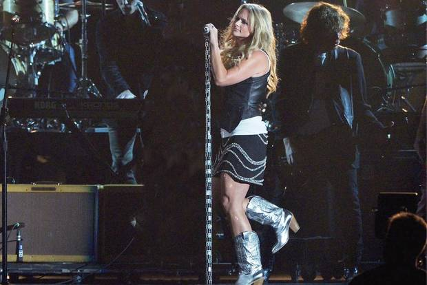Miranda Lambert performing at the Academy of Country Music Awards in a pair of metallic boots from her new line.