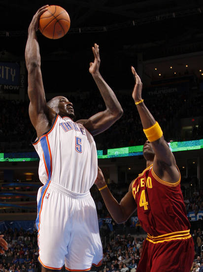 Oklahoma City's Kendrick Perkins (5) shoots the ball over Cleveland's Antawn Jamison (4) during the NBA basketball game between the Oklahoma City Thunder and the Cleveland Cavaliers at Chesapeake Energy Arena in Oklahoma City, Friday, March 9, 2012. Photo by Bryan Terry, The Oklahoman