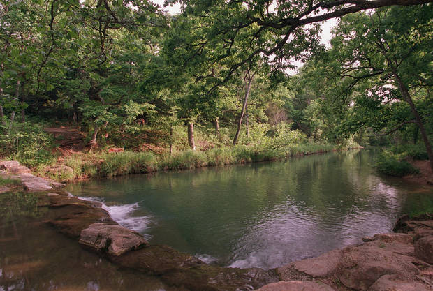 Travertine Creek flows over a man-made dam in the Chickasaw National Recreation Area in Sulphur.