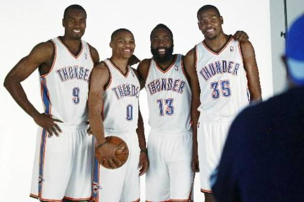 Oklahoma City Thunder stars, from left, Serge Ibaka (9), Russell Westbrook (0), James Harden (13) and Kevin Durant (35) pose for a photographer during their NBA basketball media day in Oklahoma City, Monday, Oct. 1, 2012. (AP Photo)