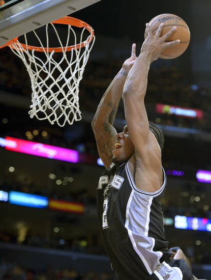 San Antonio Spurs forward Kawhi Leonard dunks against the Los Angeles Lakers during the first half in Game 3 of a first-round NBA basketball playoff series, Friday, April 26, 2013, in Los Angeles. (AP Photo/Mark J. Terrill)
