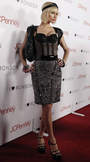 Paris Hilton arrives at the Charlotte Ronson and JCPenney party in Los Angeles on Friday, April 3, 2009.  (AP Photo/Matt Sayles) ORG XMIT: CAMW104