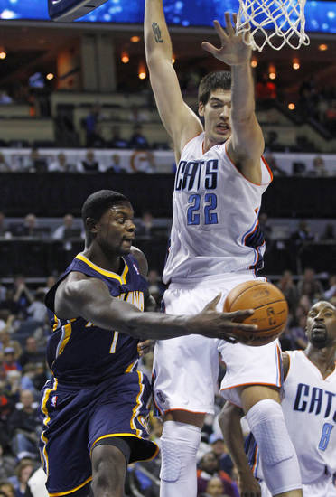 Indiana Pacers' Lance Stephenson (1) passes the ball around Charlotte Bobcats' Byron Mullens (22) during the first half of an NBA basketball game in Charlotte, N.C., Friday, Nov. 2, 2012. (AP Photo/Chuck Burton)