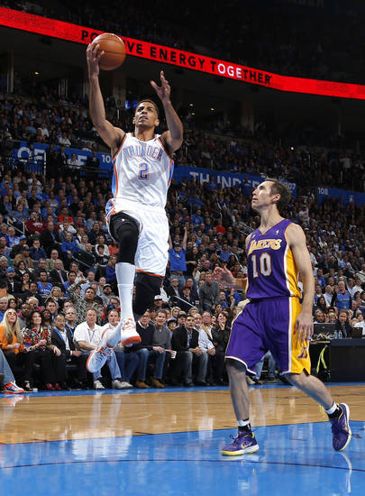 Oklahoma City's Thabo Sefolosha goes to the basket past Los Angeles' Steve Nash during an NBA basketball game between the Oklahoma City Thunder and the Los Angeles Lakers at Chesapeake Energy Arena in Oklahoma City, Tuesday, March 5, 2013. Photo by Bryan Terry, The Oklahoman