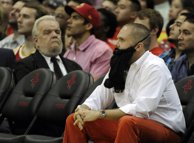 A fan wears a fake beard looks on in the first half of an NBA basketball game between the Houston Rockets and the Portland Trail Blazers, Saturday, Nov. 3, 2012, in Houston. (AP Photo/Pat Sullivan)