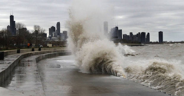 Strong waves crash against the Lake Michigan waterfront at the 31st Street Beach on the south side of Chicago on Tuesday, Oct. 30, 2012. Strong winds from the outer edge of superstorm Sandy are creating near-record high waves on Lake Michigan. (AP Photo/Charles Rex Arbogast) ORG XMIT: ILCA102