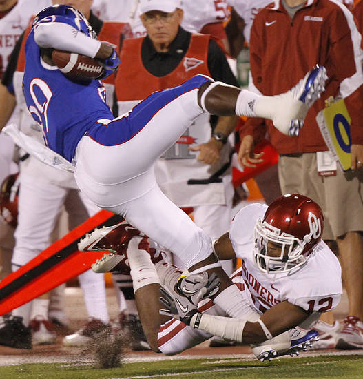 Oklahoma's Aaron Colvin (12) brings down Kansas' JaCorey Shepherd (89) during the college football game between the University of Oklahoma Sooners (OU) and the University of Kansas Jayhawks (KU) on Saturday, Oct. 15, 2011. in Lawrence, Kan. Photo by Chris Landsberger, The Oklahoman