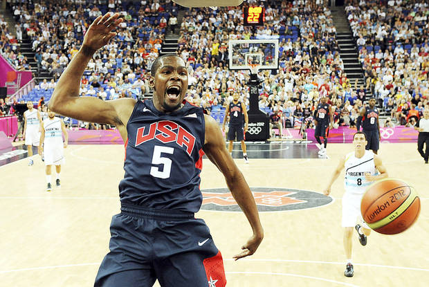 Thunder forward Kevin Durant jumps for the ball during the Summer Olympics. Durant, along James Harden, Russell Westbrook and Serge Ibaka will likely see limited action this preseason after their summer in the Olympics. AP Photo
