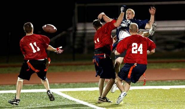 Fireman Cody Brook, 11, picks off a deflected pass during the police and firemen Guns and Hoses charity football game to benefit Compassionate Pointe on Tuesday, Oct. 30, 2012 in Norman, Okla. Photo by Steve Sisney, The Oklahoman