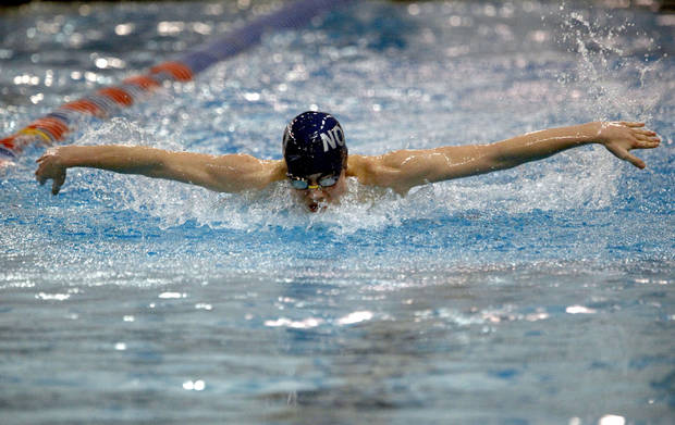 Edmond North's Michael Britton swims in the Boy's 100-yard butterfly during the 6A state championship swim meet at  Oklahoma City Community College, Saturday, Feb. 18, 2012. Photo by Sarah Phipps, The Oklahoman