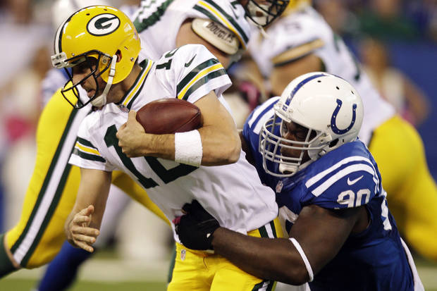 Green Bay Packers quarterback Aaron Rodgers (12) is sacked by Indianapolis Colts defensive end Cory Redding during the second half of an NFL football game in Indianapolis, Sunday, Oct. 7, 2012. (AP Photo/Michael Conroy)
