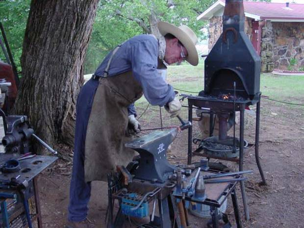 Blacksmith demo by a member of Saltfork Craftsmens Association.<br/><b>Community Photo By:</b> a member of Saltfork Craftsmen Associati<br/><b>Submitted By:</b> Karen, Harrah