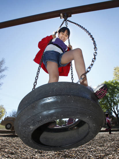 Paola Gaspar, 12, plays on a tire swing in Stephenson Park in Edmond, Friday, March 23, 2012.  Photo By David McDaniel/The Oklahoman