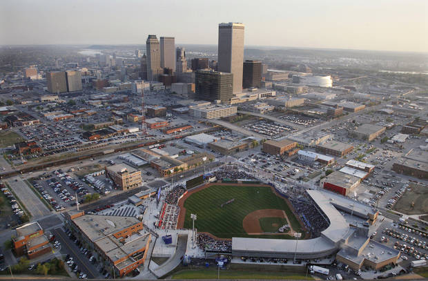 ONEOK Field stands in the foreground with the Tulsa skyline at rear. AP Photo