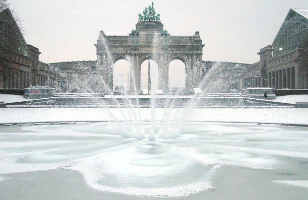 A fountain sprays water, during freezing temperatures at the Cinquantenaire park in Brussels, Monday, Jan. 21, 2013. Hundreds of fights were canceled in Britain, France and Germany Monday as snow and ice blanketed Western Europe.(AP Photo/Raf Casert)