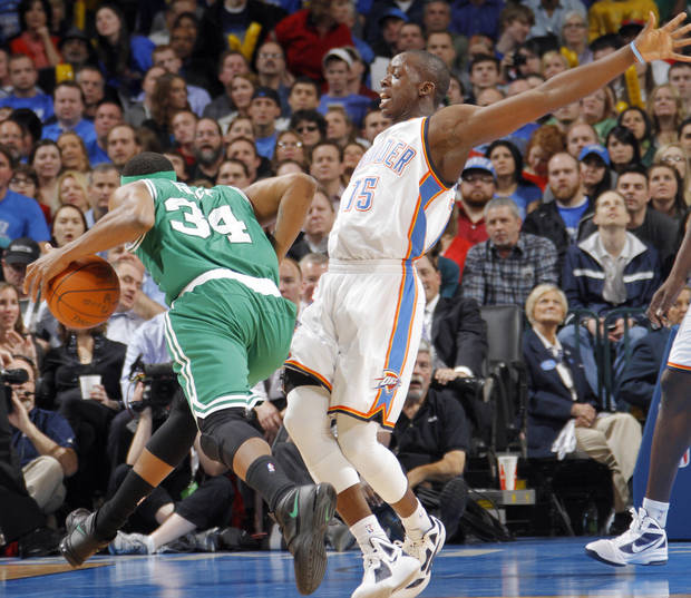 during the NBA basketball game Oklahoma City Thunder guard Reggie Jackson (15) is hit by Boston Celtics small forward Paul Pierce (34) between the Oklahoma City Thunder and the Boston Celtics at the Chesapeake Energy Arena on Wednesday, Feb. 22, 2012 in Oklahoma City, Okla.  Photo by Chris Landsberger, The Oklahoman