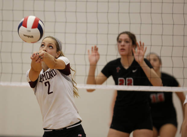 Edmond Memorial's Lindsey Roy (2) hits a ball during the OSSAA 6A State Volleyball Championship between Bishop Kelley and Edmond Memorial at Westmoore High School in Moore, Okla., Saturday, Oct. 13, 2012.  Photo by Garett Fisbeck, The Oklahoman