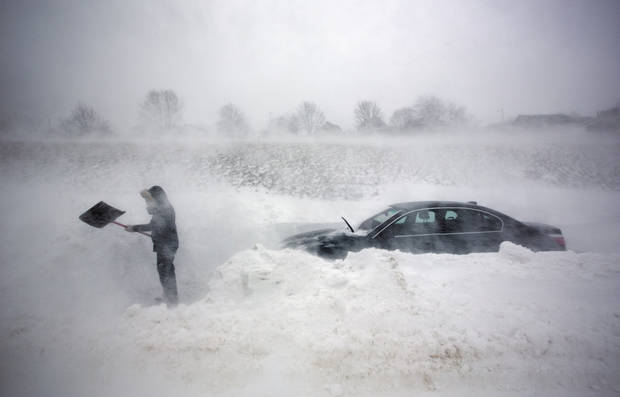 A woman digs out her car after it was blocked in by drifting snow during a blizzard, Saturday, Feb. 9, 2013, in Portland, Maine. The storm dumped more than 30 inches of snow as of Saturday afternoon, breaking the record for the biggest storm on record. (AP Photo/Robert F. Bukaty) ORG XMIT: MERB105