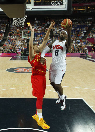 Lebron James (6) of the United States is guarded by Spain's Marc Gasol (13) during their men's gold medal basketball game at the 2012 Summer Olympics on Sunday, Aug. 12, 2012, in London. (AP Photo/Sergio Perez, Pool)