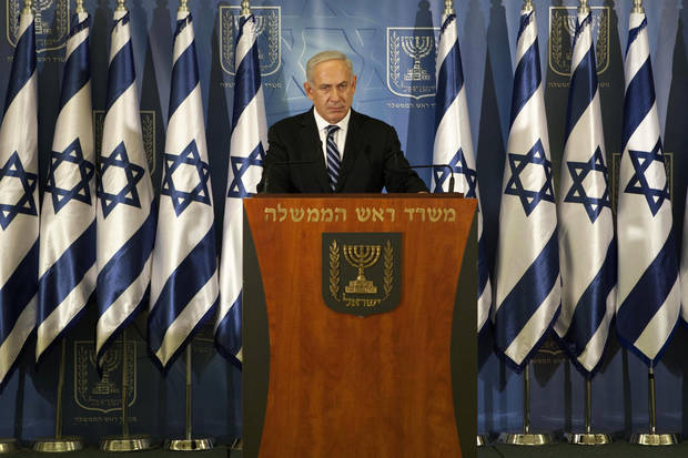 "Israeli prime minister Benjamin Netanyahu speaks to the media in Tel Aviv, Israel, Thursday, Nov. 15, 2012. Netanyahu told reporters on Thursday that Israel has ""made it clear"" it won't tolerate continued rocket fire on its civilians. (AP Photo/Dan Balilty)"