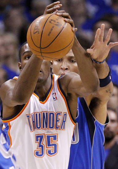 Oklahoma City's Kevin Durant (35) has the ball knocked away by Shawn Marion (0) of Dallas during game 3 of the Western Conference Finals of the NBA basketball playoffs between the Dallas Mavericks and the Oklahoma City Thunder at the OKC Arena in downtown Oklahoma City, Saturday, May 21, 2011. Photo by Chris Landsberger, The Oklahoman