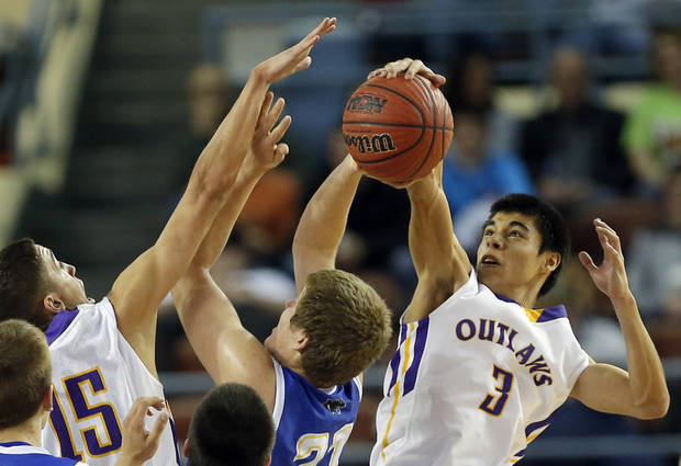 Weleetka's Shaun Bencoma, right, and Jackson Frye block the shot of Glencoe's Hunter Hall during the Class A boys state championship between Glencoe and Weleetka  at the State Fair Arena., Saturday, March 2, 2013. Photo by Sarah Phipps, The Oklahoman
