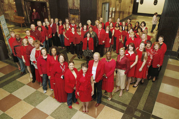 Oklahoma County Court Clerk Patricia Presley's office all dressed in red for the American Heart Association's Go Red For Women day at the Oklahoma County Courthouse in Oklahoma City, OK, Friday, Feb. 3, 2012. By Paul Hellstern, The Oklahoman