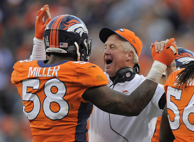 Denver Broncos outside linebacker Von Miller (58) is congratulated by head coach John Fox after intercepting a pass and running it back for a touchdown against the Tampa Bay Buccaneers in the third quarter of an NFL football game, Sunday, Dec. 2, 2012, in Denver. (AP Photo/Jack Dempsey)