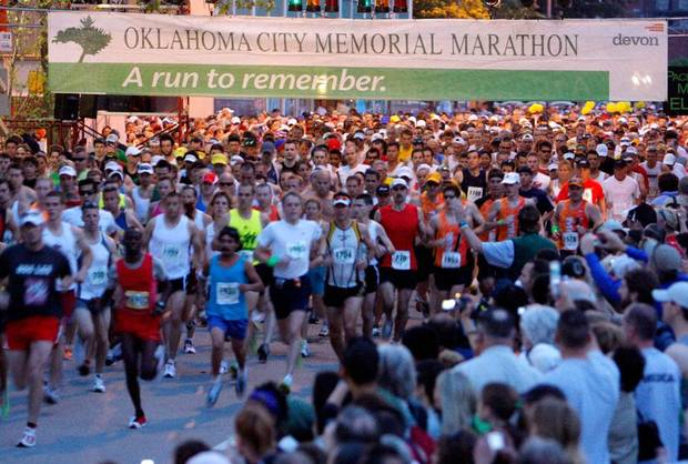 National Memorial at the beginning oRunners make their way past the OKC f the Oklahoma City Memorial Marathon Sunday, April 26, 2009. Photo by Doug Hoke, The Oklahoman.
