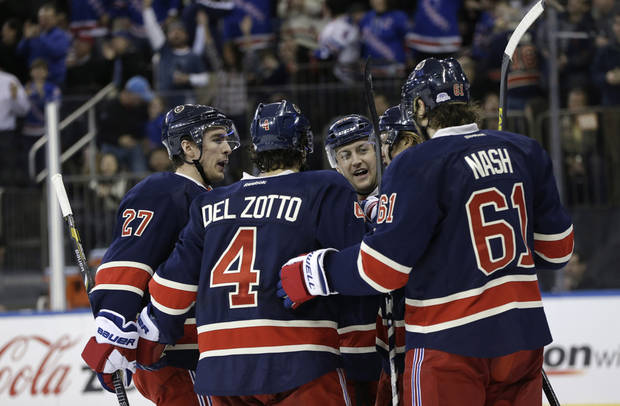 New York Rangers celebrate with left wing Carl Hagelin, second from right, of Sweden, after he scored a goal in the second period of their NHL hockey game agaainst the Washington Capitals at Madison Square Garden in New York, Sunday, Feb. 17, 2013. From left to right, are: defenseman Ryan McDonagh, defenseman Michael Del Zotto, Derek Stepan, Hagelin and left wing Rick Nash. (AP Photo/Kathy Willens)